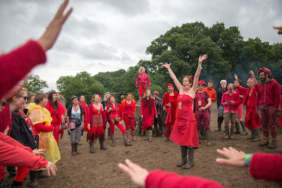GLASTONBURY, ENGLAND - JUNE 26: The Shakti Sings choir perform at the Stone Circle at the Glastonbury Festival 2016 at Worthy Farm, Pilton on June 25, 2016 near Glastonbury, England. The Festival, which Michael Eavis started in 1970 when several hundred hippies paid just £1, now attracts more than 175,000 people. (Photo by Matt Cardy/Getty Images)